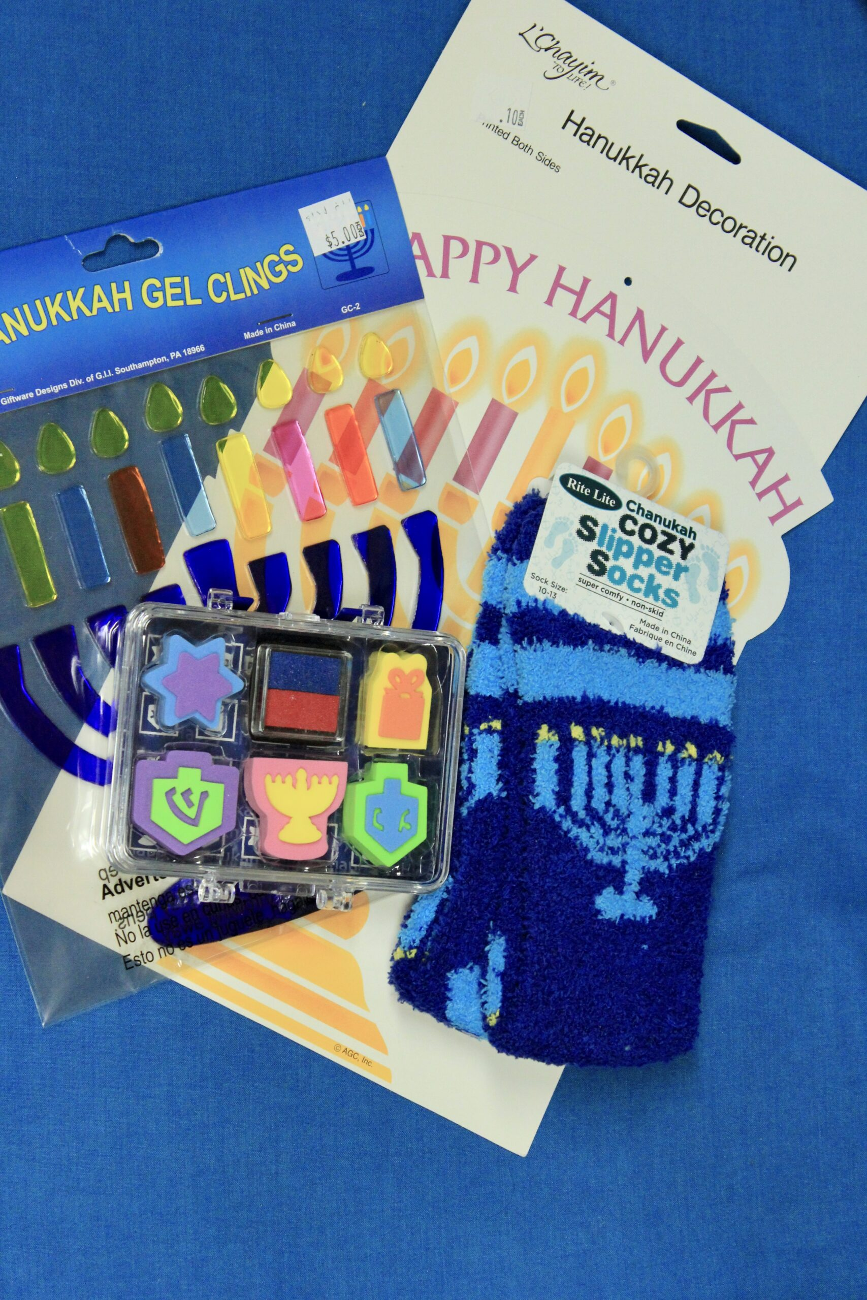 Fuzzy Socks, Stamp Set, Menorah Gel Cling and Paper Decor $12 (5 available)
